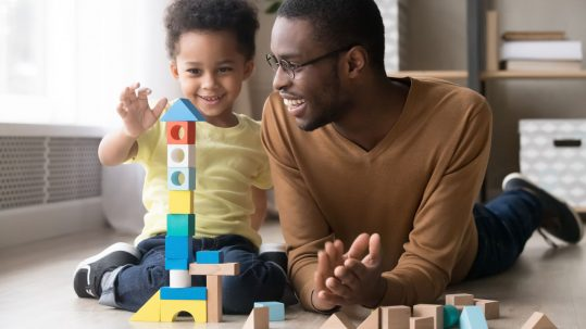 Dad and son playing with blocks