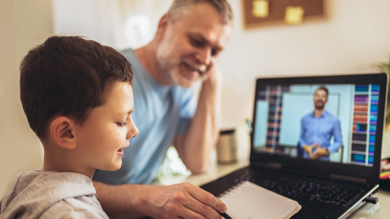 Dad helping son with remote learning